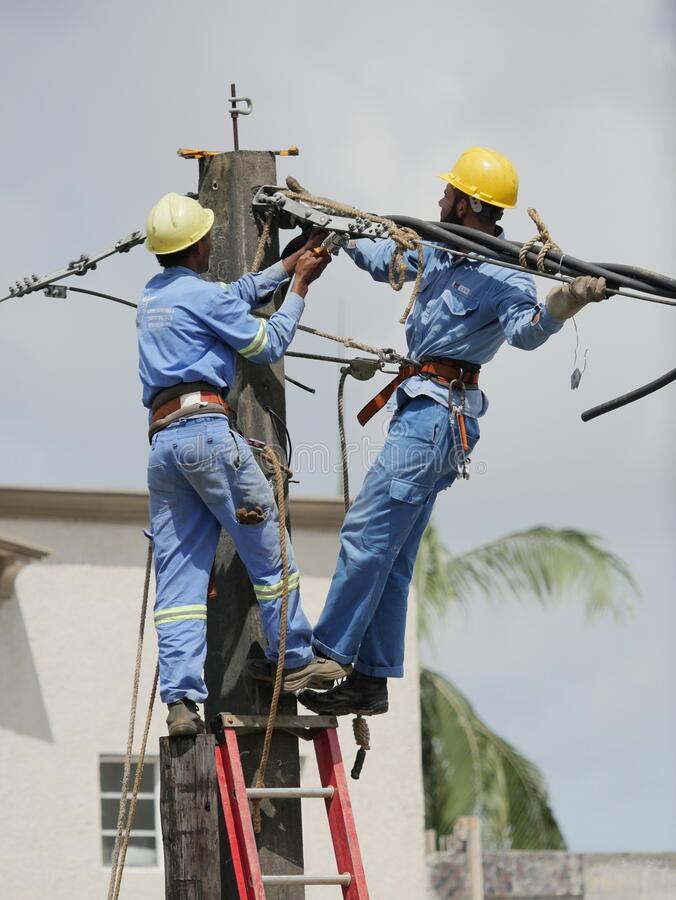 Men at work on electricity column royalty free stock photography