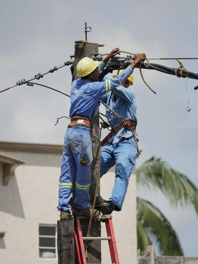 Men at work on electricity column royalty free stock images