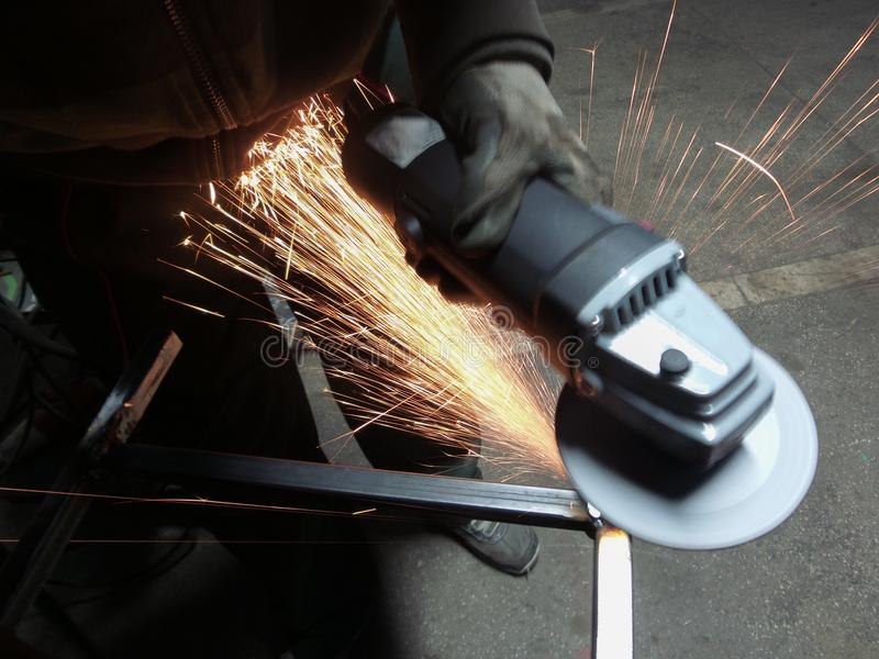 Men at work grinding steel stock photography
