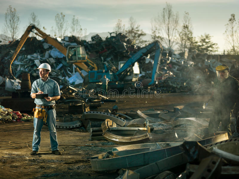 Men at work in recycling center stock images