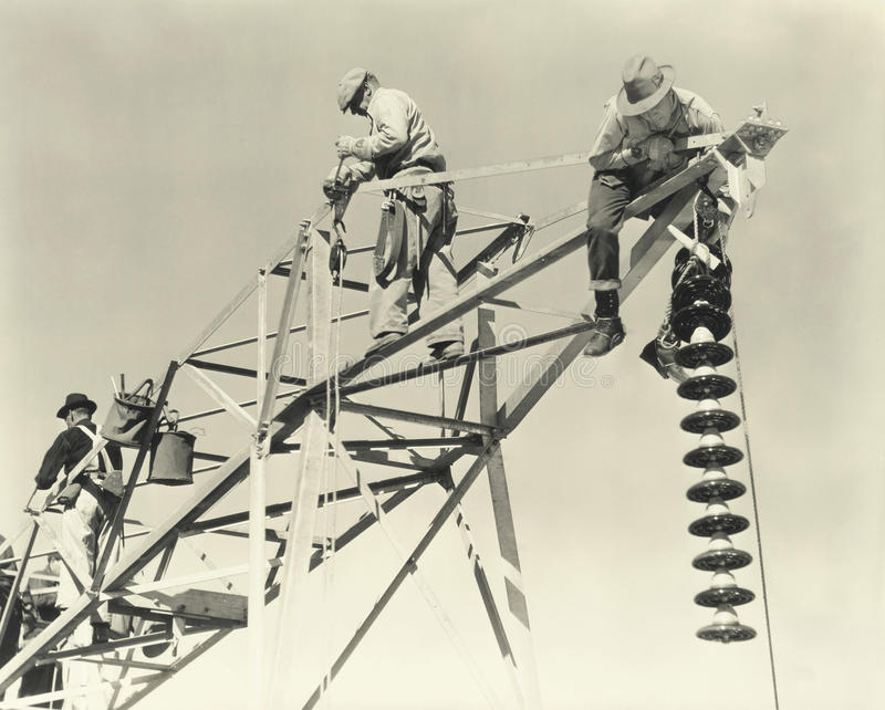 Men working on power lines royalty free stock images