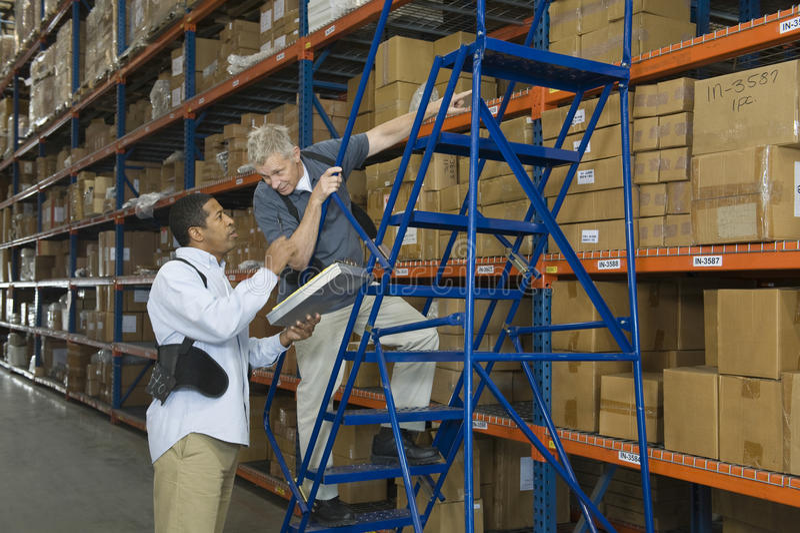 Men Working In Warehouse stock photo