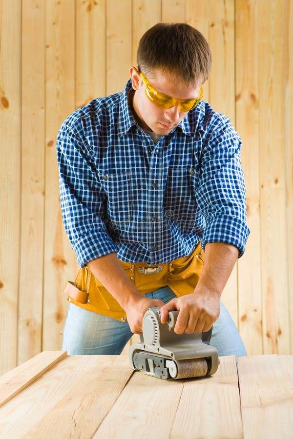 Men works with detail sander stock images
