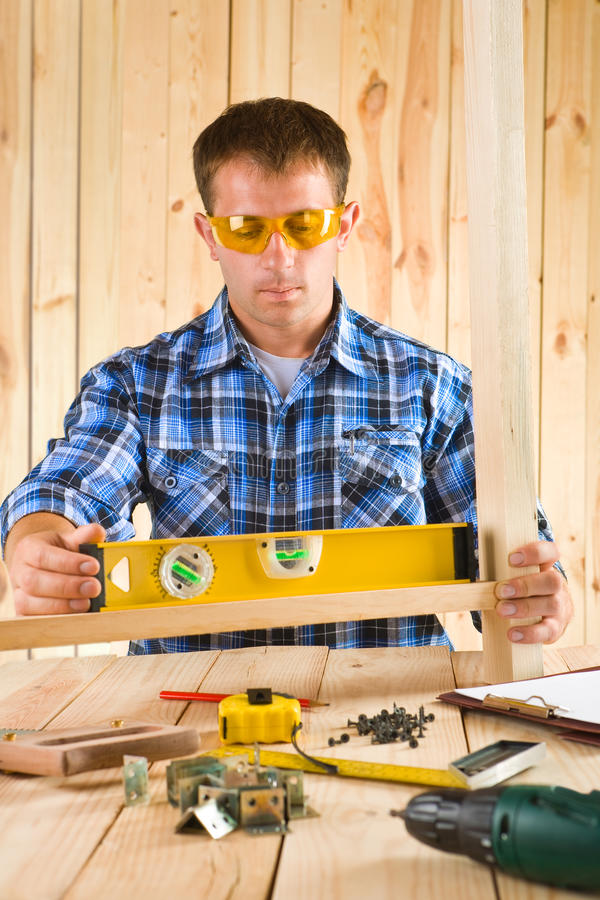 Download Men works with the level stock photo. Image of manual - 26079458