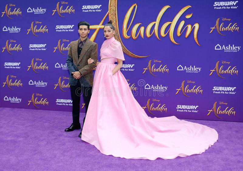 Mena Massoud and Naomi Scott. At the Los Angeles premiere of `Aladdin` held at the El Capitan Theatre in Hollywood, USA on May 21, 2019 stock photos