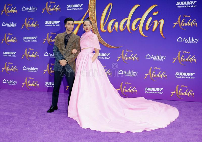 Mena Massoud and Naomi Scott. At the Los Angeles premiere of `Aladdin` held at the El Capitan Theatre in Hollywood, USA on May 21, 2019 royalty free stock image