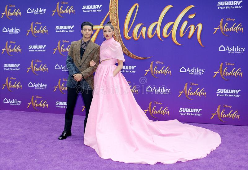 Mena Massoud and Naomi Scott. At the Los Angeles premiere of `Aladdin` held at the El Capitan Theatre in Hollywood, USA on May 21, 2019 stock images