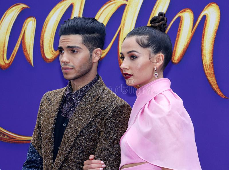 Mena Massoud and Naomi Scott. At the Los Angeles premiere of `Aladdin` held at the El Capitan Theatre in Hollywood, USA on May 21, 2019 royalty free stock photos