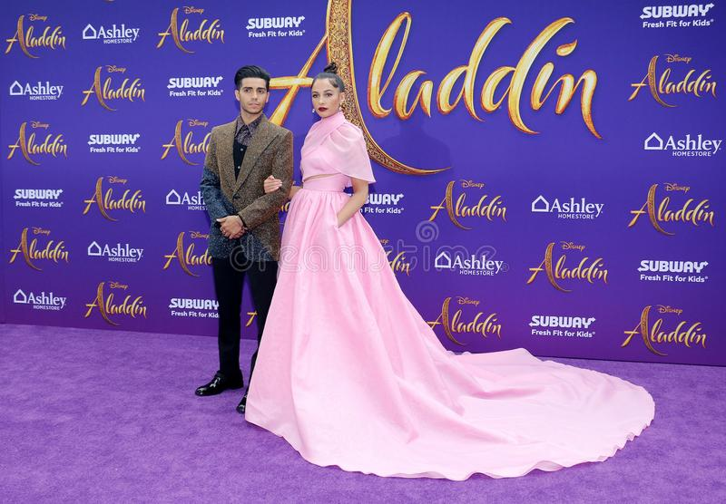 Mena Massoud and Naomi Scott. At the Los Angeles premiere of `Aladdin` held at the El Capitan Theatre in Hollywood, USA on May 21, 2019 stock photo