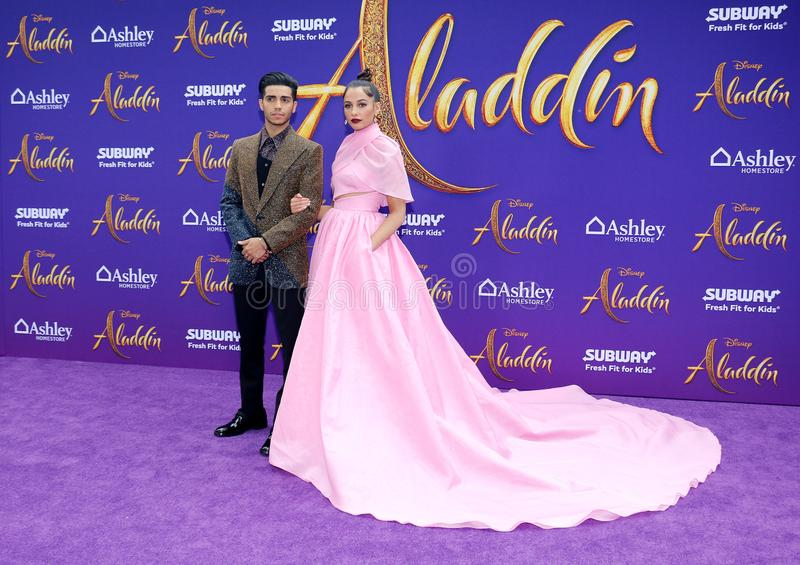 Mena Massoud and Naomi Scott. At the Los Angeles premiere of `Aladdin` held at the El Capitan Theatre in Hollywood, USA on May 21, 2019 stock photography