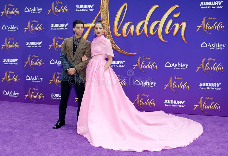 Mena Massoud and Naomi Scott. At the Los Angeles premiere of `Aladdin` held at the El Capitan Theatre in Hollywood, USA on May 21, 2019 royalty free stock photo
