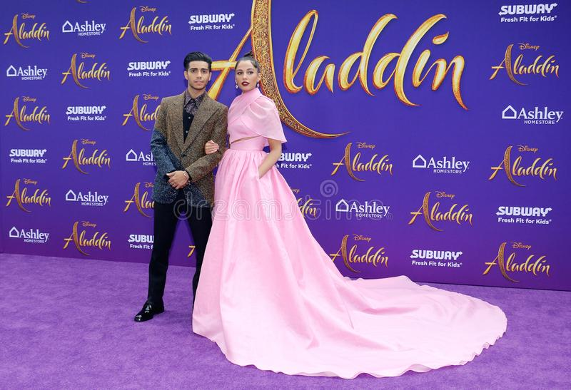 Mena Massoud and Naomi Scott. At the Los Angeles premiere of `Aladdin` held at the El Capitan Theatre in Hollywood, USA on May 21, 2019 stock image