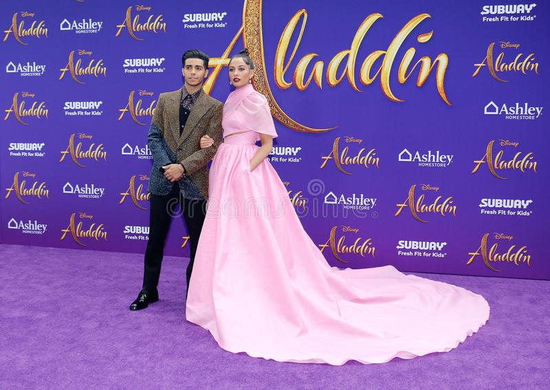 Mena Massoud and Naomi Scott. At the Los Angeles premiere of `Aladdin` held at the El Capitan Theatre in Hollywood, USA on May 21, 2019 royalty free stock photography