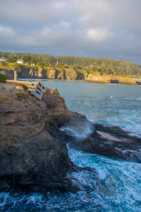 Mendocino Headlands Spring Sunset Blow Hole. Foam shoots out of a blow hole on the Mendocino Headlands on a spring afternoon in northern California royalty free stock photos