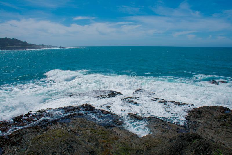 Mendocino Headlands Surf. Surf crashes against the Mendocino Headlands on a  sunny spring afternoon royalty free stock photo