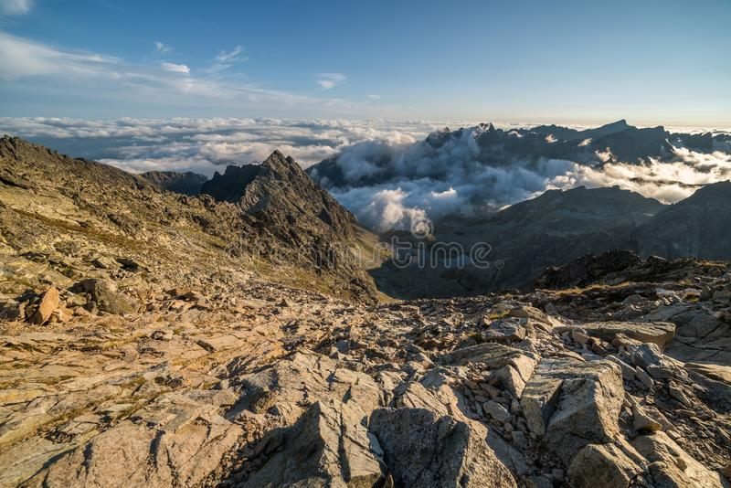 Mountains with Inversion at Sunset. Mengusovska Valley with Inversion as Seen from Rysy Peak in High Tatras, Slovakia royalty free stock images