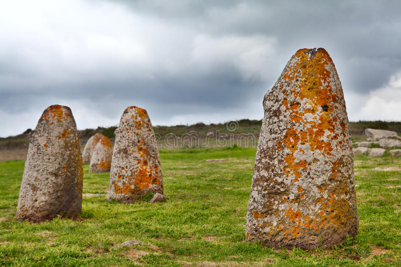 Menhir sardinia megalith stone. Merhir megalith monolith stone in Sardinia Sardegna Italy big megalith stone standing in field archaeological monument at Macomer stock photo