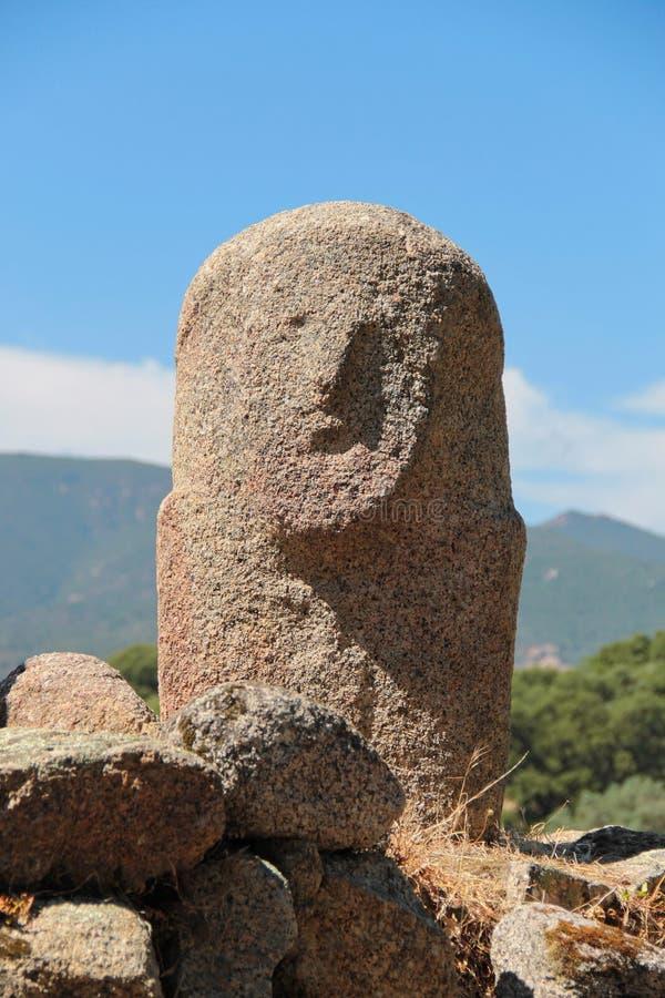 Menhirs with human faces at Filitosa archeological site. Menhirs with human faces and bodies at Filitosa archeological site, from a mysterious neolythic and royalty free stock photo