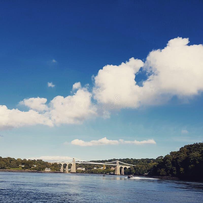 Menia Straits Bridge in the distance stock photography