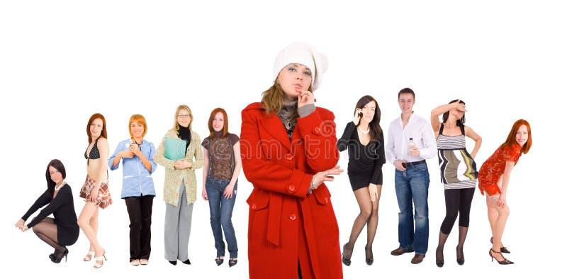 Menigte van jonge mensen de - en één geklede winter gir stock foto