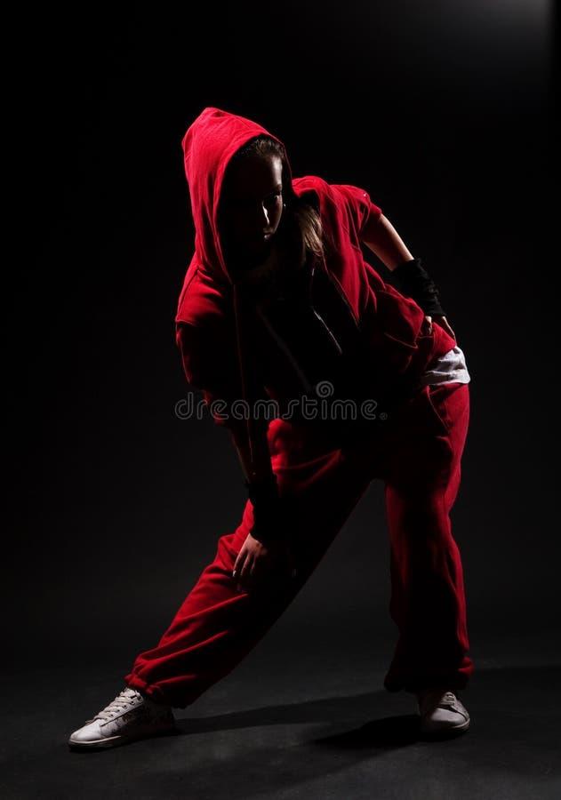 Menina à moda do lúpulo do quadril no vermelho imagem de stock