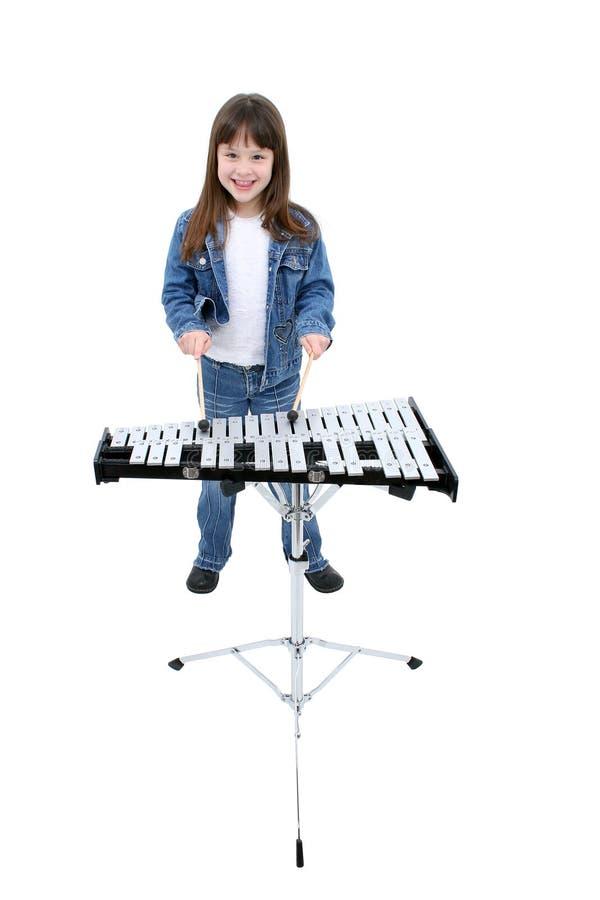 Download Menina (7 Anos) Que Joga As Bels Imagem de Stock - Imagem de xylophone, ritmo: 64449