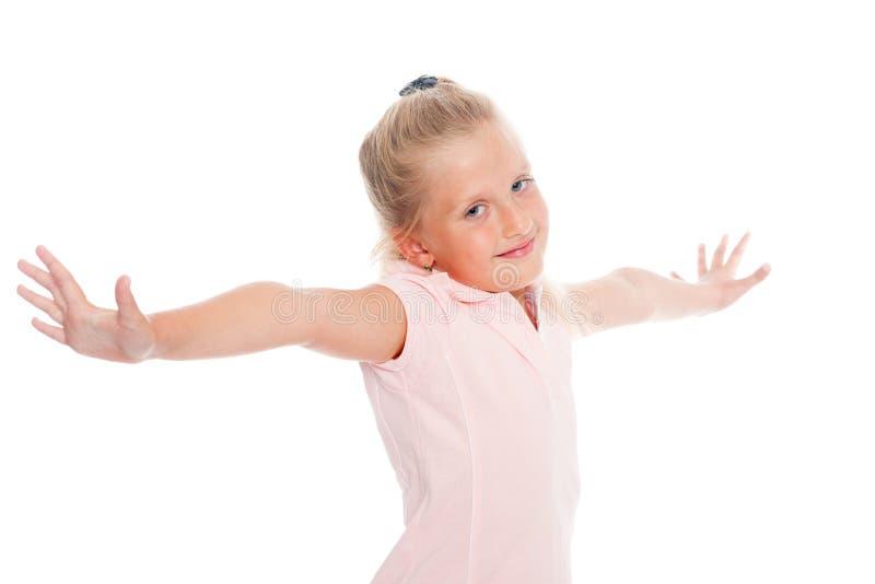 A menina abriu seus braços aos lados imagens de stock royalty free