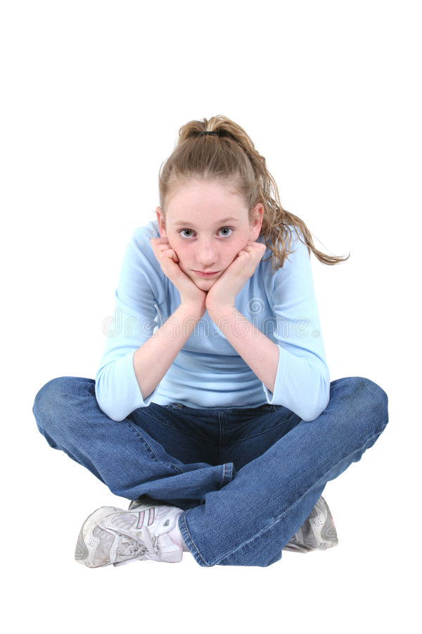 Menina adolescente bonito no azul e na sarja de Nimes imagens de stock royalty free