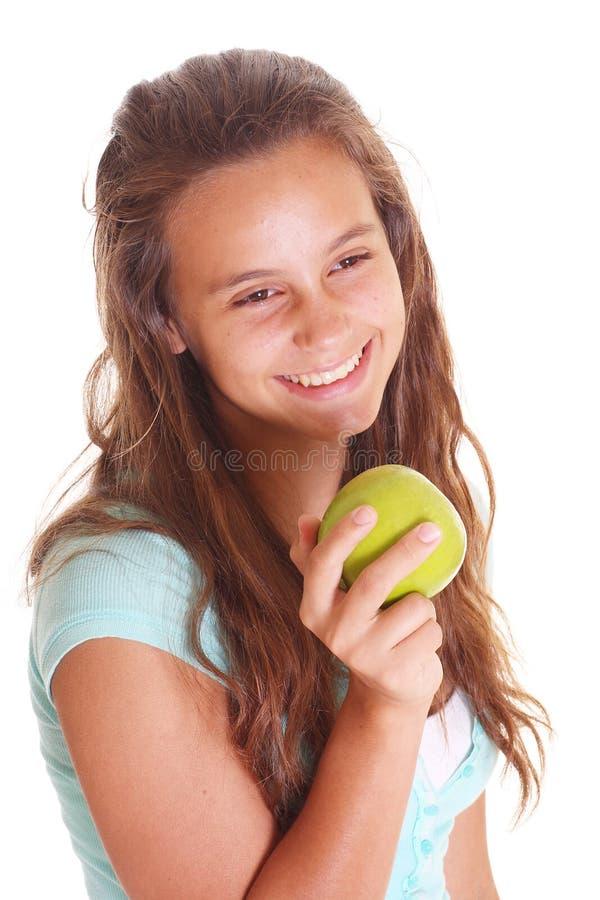 Menina adolescente com maçã fotografia de stock royalty free