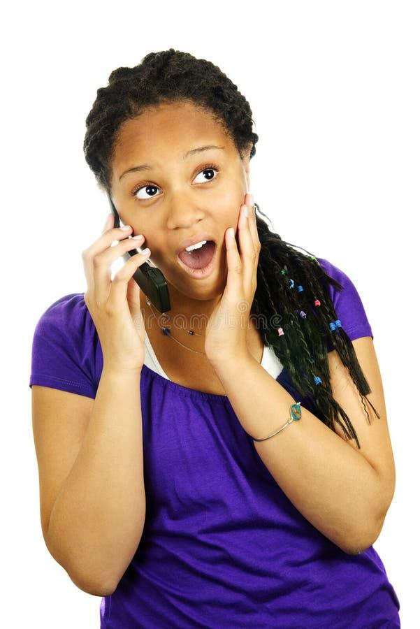 Menina adolescente com telefone móvel imagem de stock