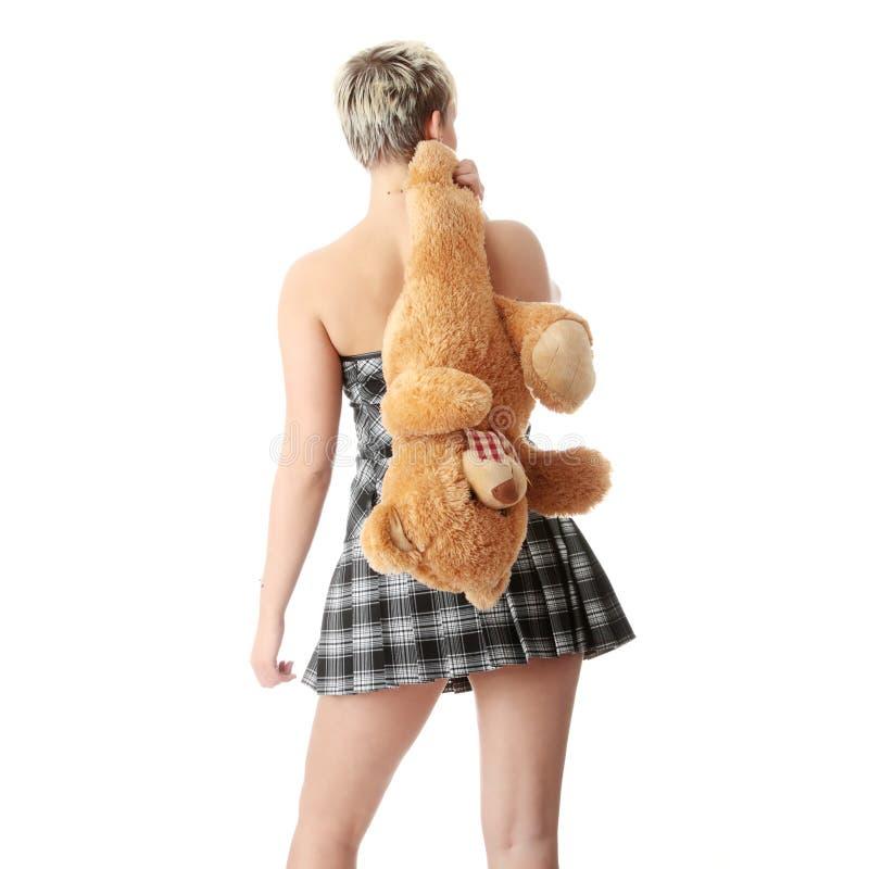 Menina adolescente do punk com peluche imagem de stock