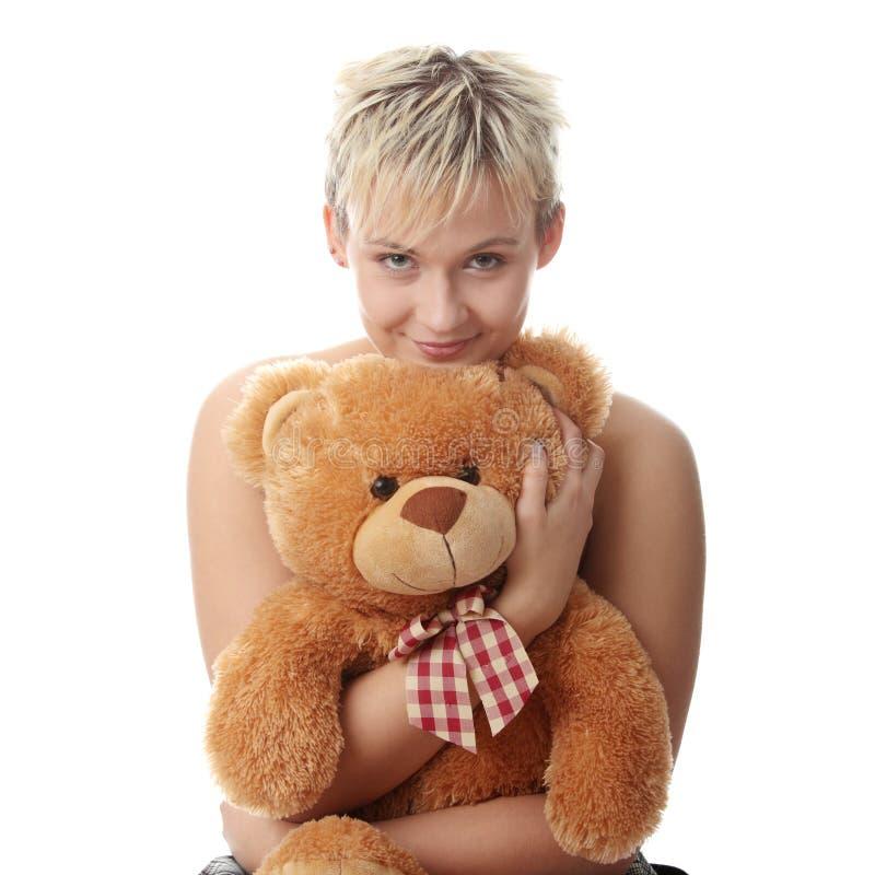 Menina adolescente do punk com urso de peluche fotos de stock