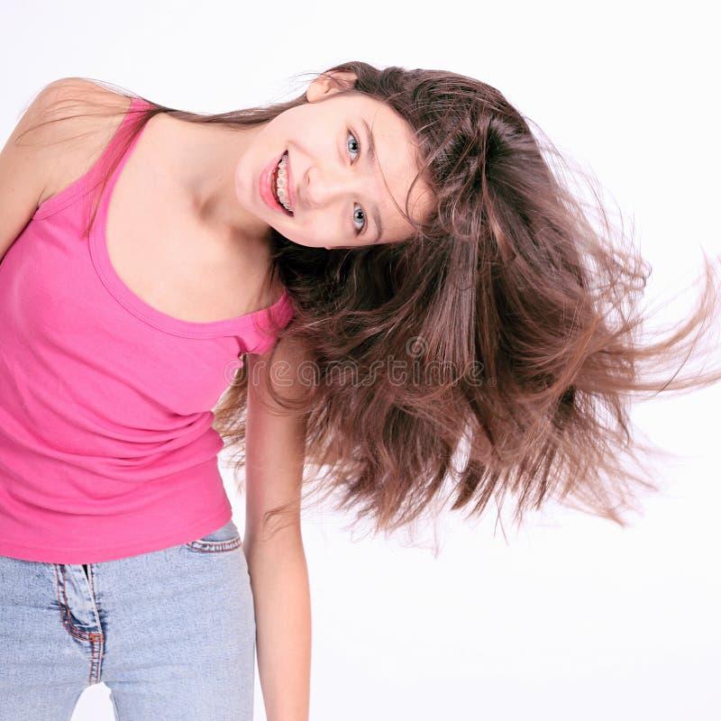 Menina adolescente nova bonita com suportes foto de stock royalty free