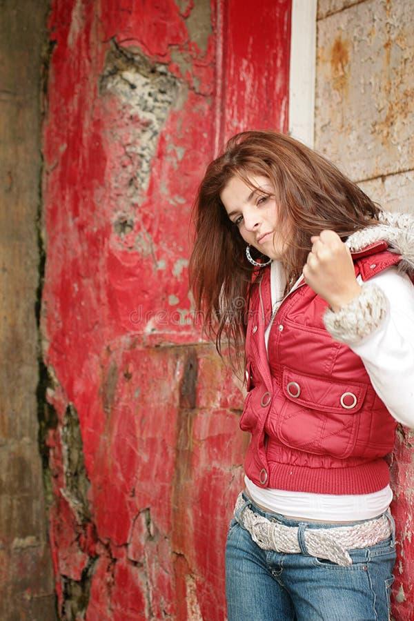 Menina adolescente nova com punho acima fotografia de stock