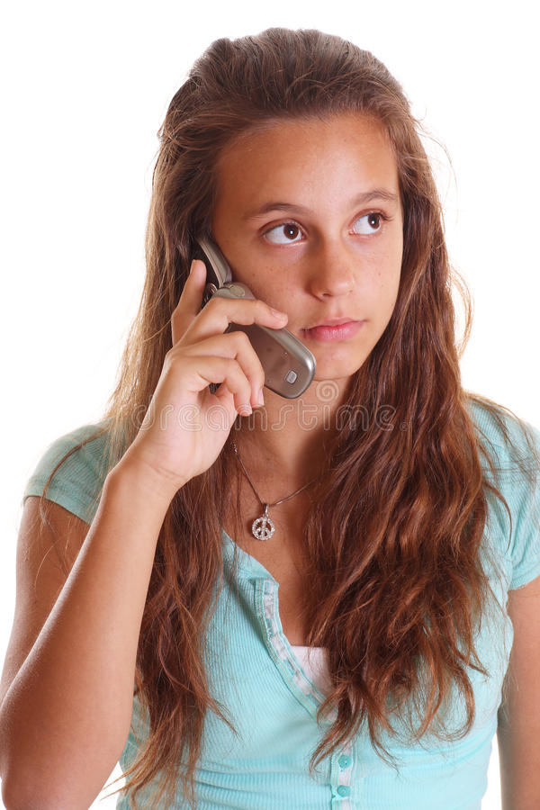 Menina adolescente que escuta no telefone de pilha foto de stock