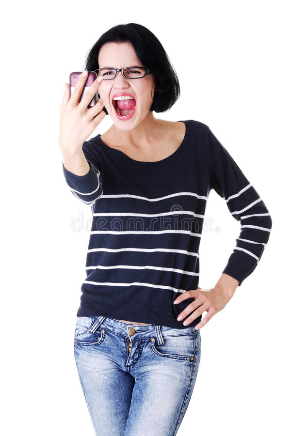 Menina adolescente que usa o telemóvel, isolado no branco imagens de stock