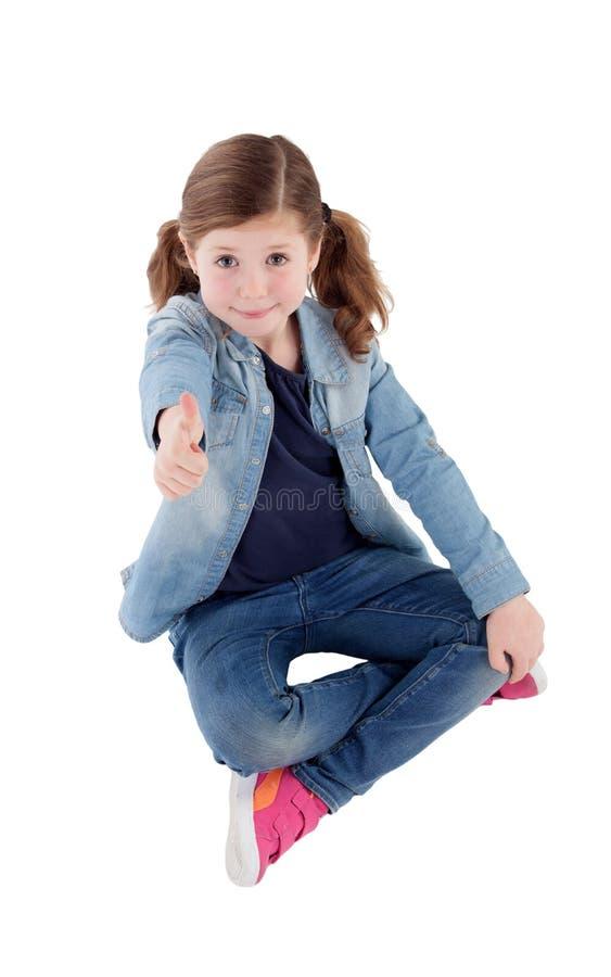 Menina adorável com dizer a aprovação fotos de stock royalty free