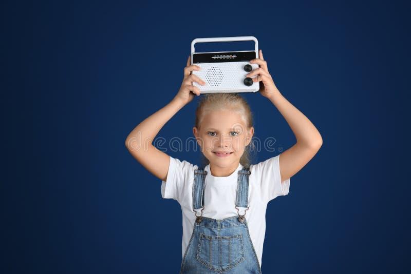 Menina adorável com rádio imagens de stock royalty free