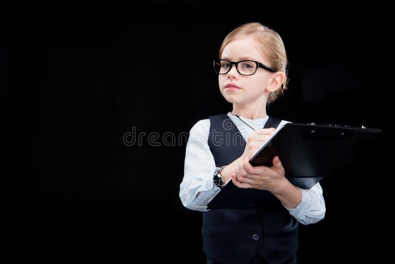 Menina adorável pensativa com dobrador fotos de stock