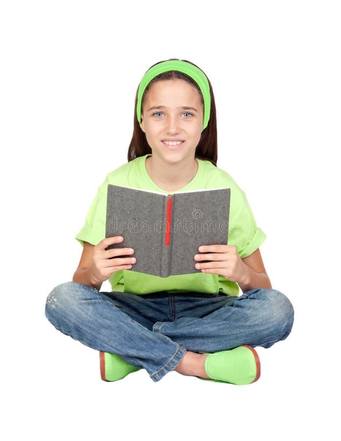 Menina adorável que lê um livro fotografia de stock