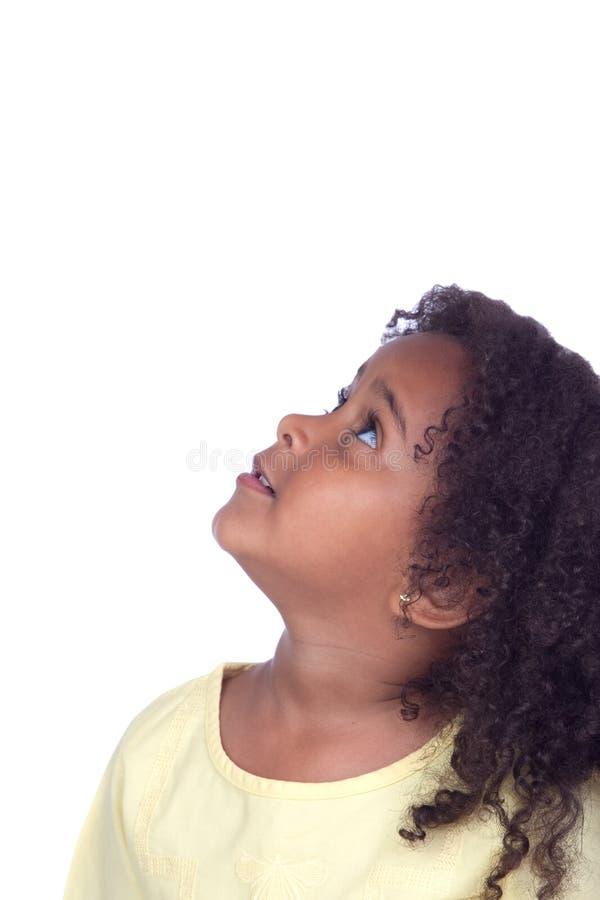 Menina africana agradável que olha acima fotografia de stock royalty free