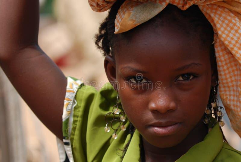 Menina africana com braço levantado fotografia de stock royalty free