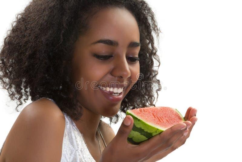 Menina africana com melancia imagem de stock royalty free