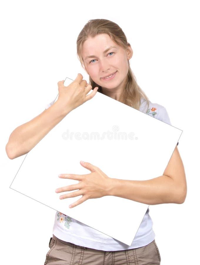 Menina agradável com pedaço de papel branco fotografia de stock