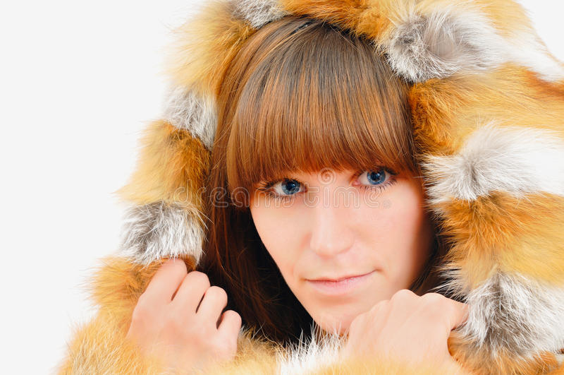 Menina agradável na pele de raposa imagens de stock royalty free