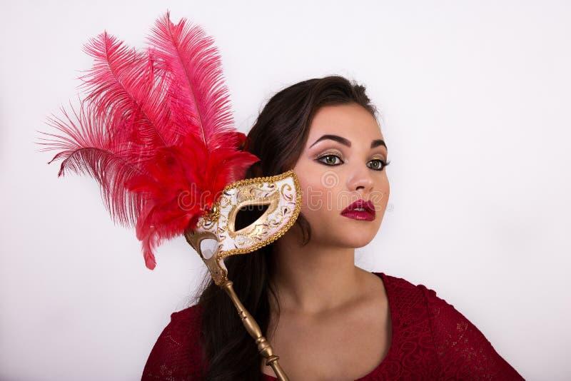 Menina agradável nova com máscara imagem de stock royalty free