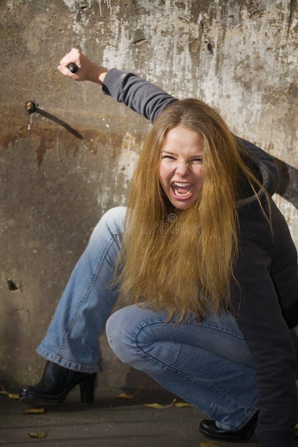 Menina agressiva fotografia de stock