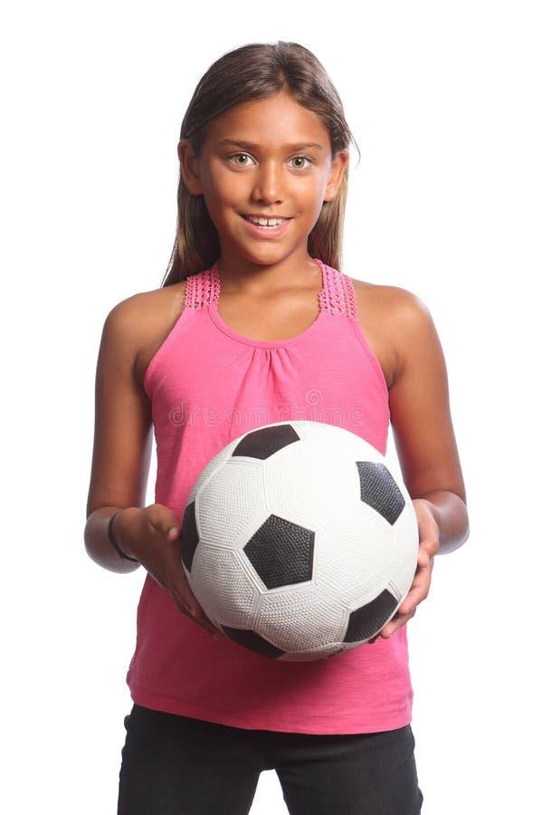 Menina alegre da escola da raça misturada com bola de futebol fotografia de stock royalty free