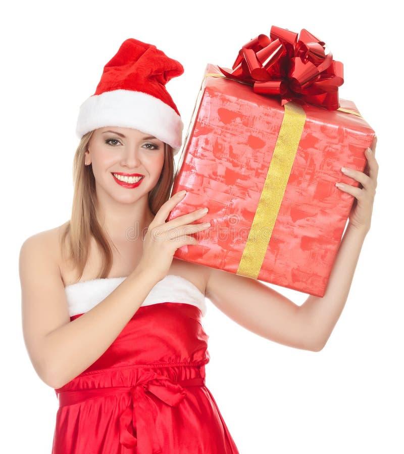 Menina alegre do ajudante de Santa com a caixa de presente grande imagem de stock