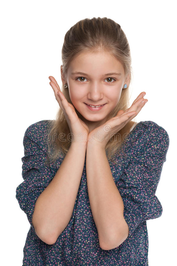Menina alegre do preteen contra o branco foto de stock
